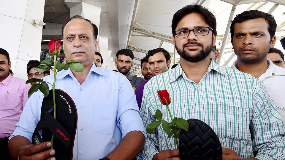 Aam Aadmi Sena activists hold roses and slippers in protest against Shiv Sena MP Ravindra Gaikwad's assault on an Air India staffer at the Delhi airport recently.