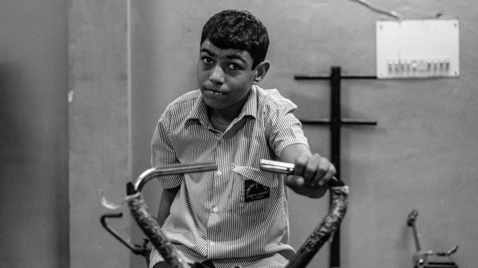Rahul makes an effort on an exercise cycle as part of his daily routine at an NGO centre in New Delhi. Autism is one of the most common neurological disorders that affects the way a child reacts to people and his immediate environment, with one out of five hundred children in India diagnosed with this medical condition. (Vageesh Lall/ HT Photo)