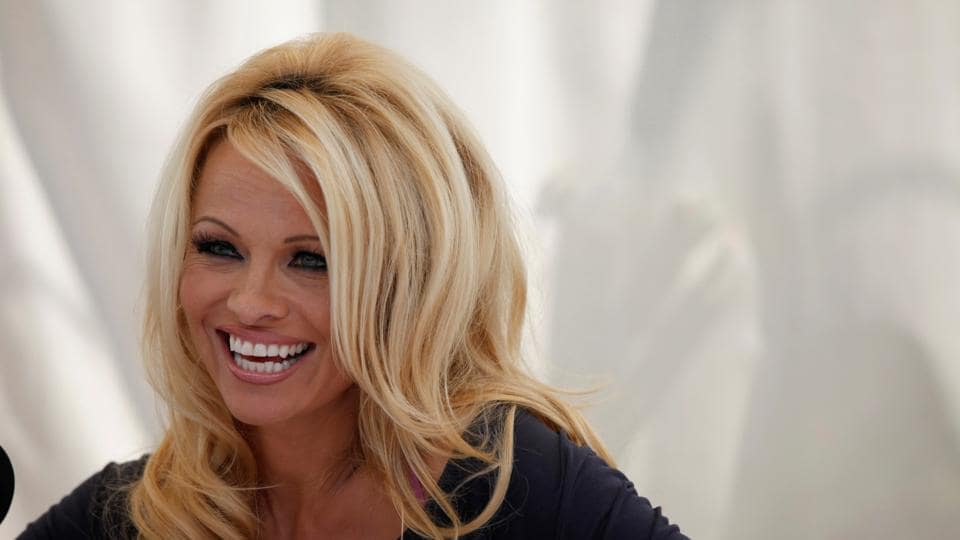 Actor Pamela Anderson answers a question at a news conference to announce the launch of the online social platform FrogAds.com, in West Hollywood.