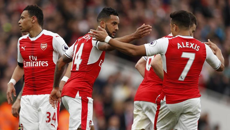Arsenal FC's Theo Walcott celebrates scoring their first goal with team mates against Manchester City FC.