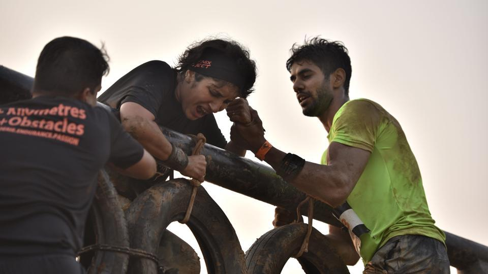 Participants helping each other during an obstacle race. (Arijit Sen/HT Photo)