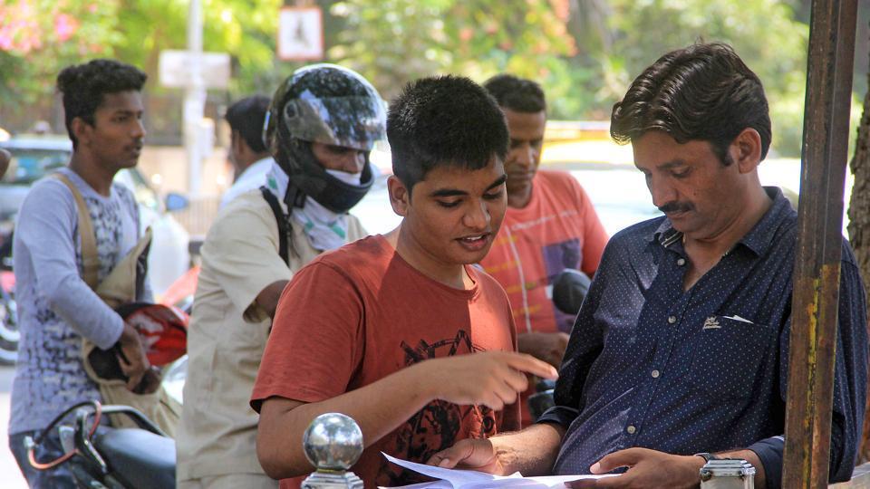 JEE aspirants outside Ramnarain Ruia College in Matunga on Sunday.