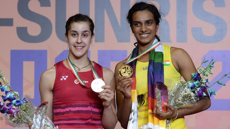 PVSindhu (R)defeated Carolina Marin to win the India Open title in New Delhi on Sunday.