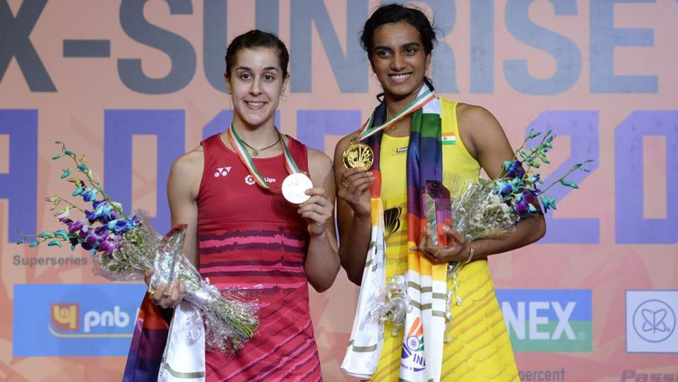 PV Sindhu (R) poses with her gold medal, with Spain's Carolina Marin with her silver medal at the India Open. (AFP)