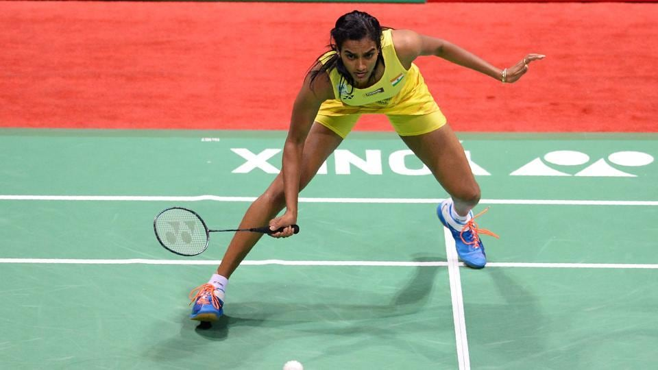PV Sindhu plays a return against Spain's Carolina Marin during their women's singles final. (AFP)