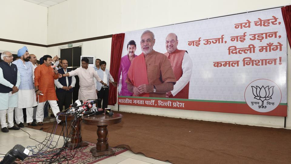 Delhi BJP president Manoj Tiwari on Friday launched a slogan Naye Chehre, Nayee Urja, Nayee Udaan, Dilli Mange Kamal Nishan (new faces, new energy, new flight, Delhi wants Lotus), for the polls.