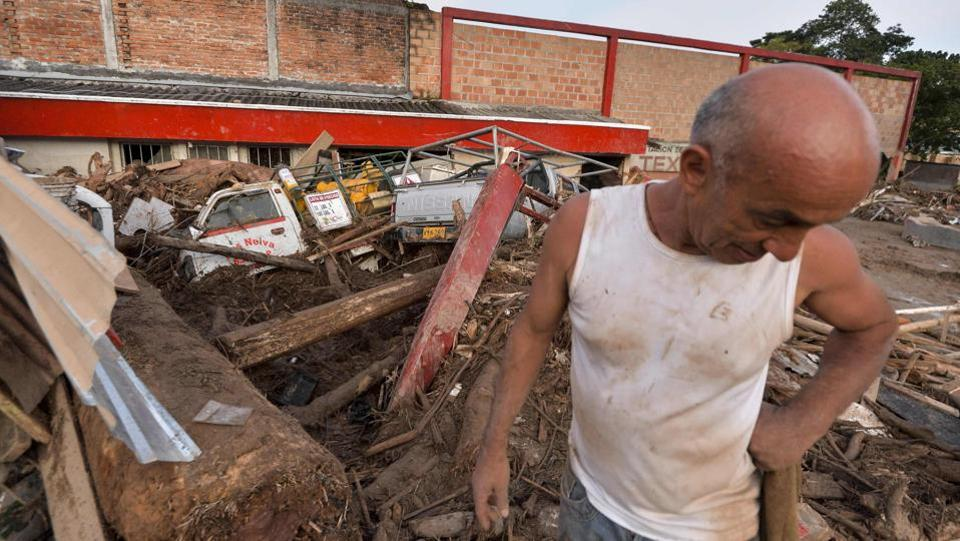 A man looks at the damage caused by mudslides following heavy rains in Mocoa, Putumayo department, southern Colombia. One thousand emergency personnel, including soldiers and local police, were helping the rescue effort.  (Luis Robayo/AFP)
