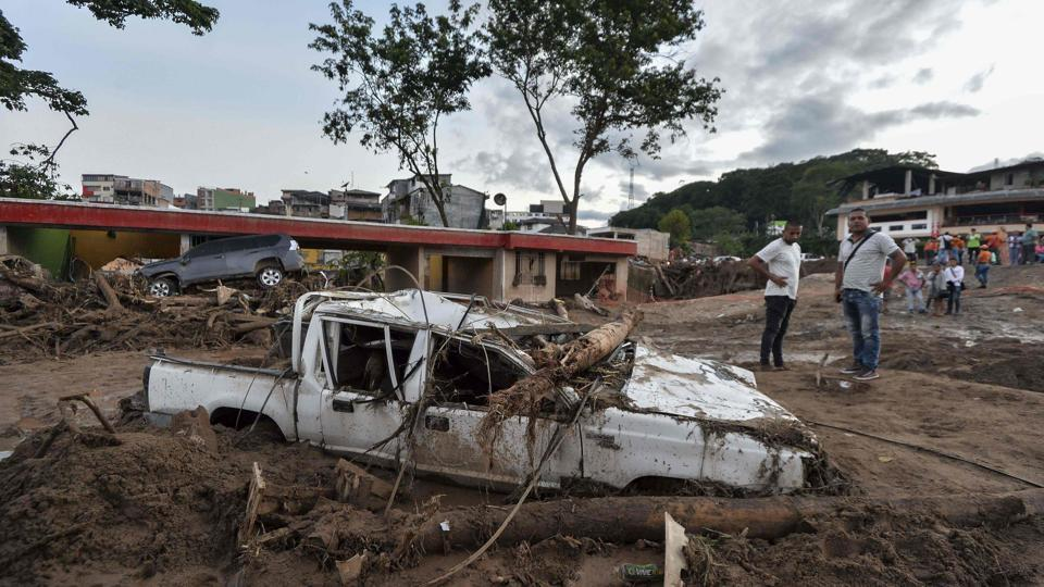 People look at the damages caused by mudslides. A landslide in November killed nine people in the rural southwestern town of El Tambo, officials said at the time. (Luis Robayo/AFP)