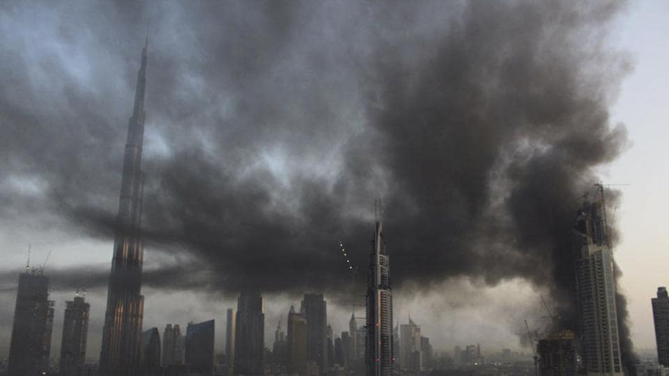 Smoke rises from a fire at a construction site next to Dubai Mall in Dubai, United Arab Emirates.
