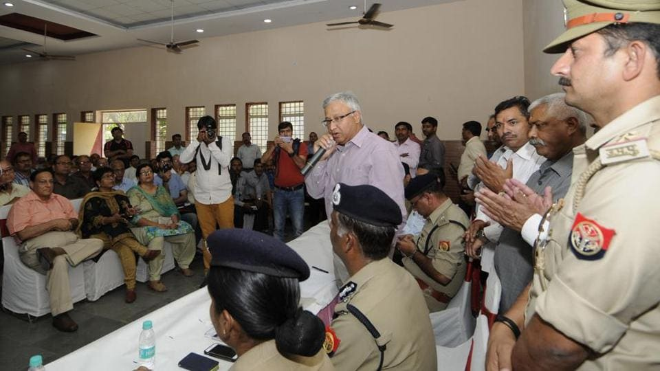 UP director general of police, Javeed Ahmad, interacts with residents on Sunday.