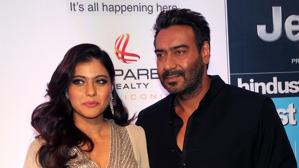 Kajol (L) and Ajay Devgn pose as they attend the HT Most Stylish awards ceremony in Mumbai.