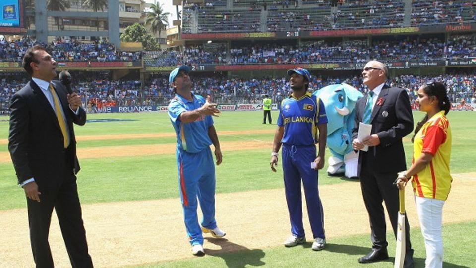MS Dhoni of India tosses the coin for the second time with Kumar Sangakkara of Sri Lanka looking on during the 2011 World Cup final at Wankhede Stadium on April 2, 2011 in Mumbai.