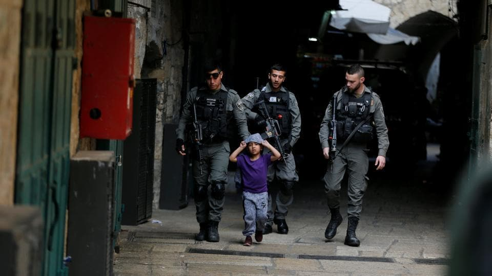 Israeli border policemen escort a boy away from a blocked alley after a stabbing attack inside the old city of Jerusalem according to Israeli police on April 1, 2017. The boy is not involved in the incident. (Ammar Awad/REUTERS)