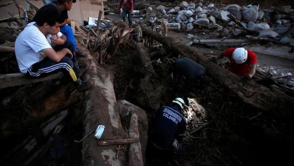 Rescue agencies look for bodies in a destroyed area after heavy rains caused several rivers to overflow. A landslide the month before killed 10 people in the north of the country. (Jaime Saldarriaga/Reuters)