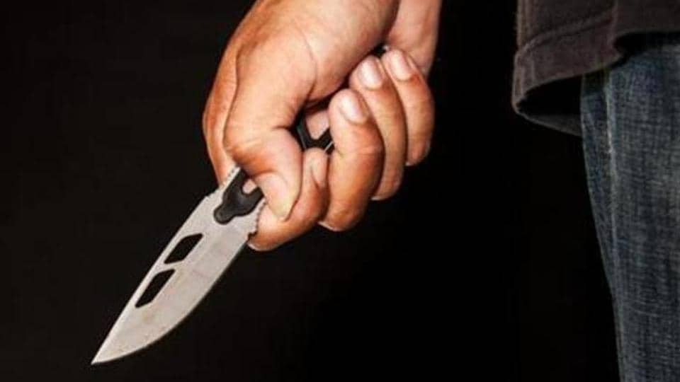 Evil criminal with large sharp knife ready for robbery or to commit a homicide (knife attack, )