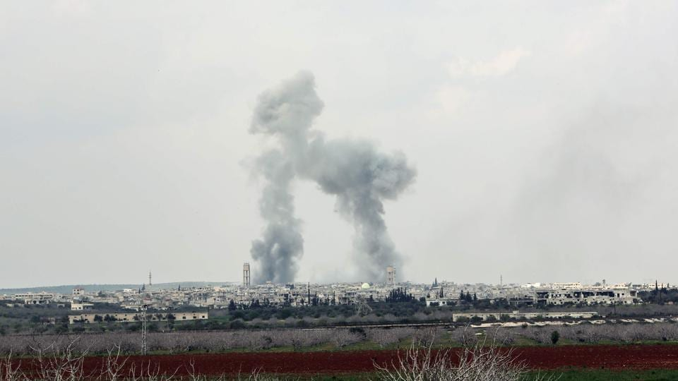 Smoke plumes rise near the town of Qumhanah in Hama province, as Syrian government forces' artillery targets positions during an assault against rebel forces.