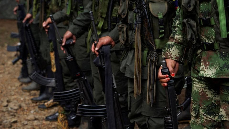 FARC members stand during a formation in a camp before moving to the transitional zone of Pueblo Nuevo. The Revolutionary Armed Forces of Colombia (FARC) signed a peace agreement with the government late last year to put an end to their part in Latin America's longest-running armed conflict, which has killed more than 220,000 people and displaced millions. (Federico Rios/REUTERS)
