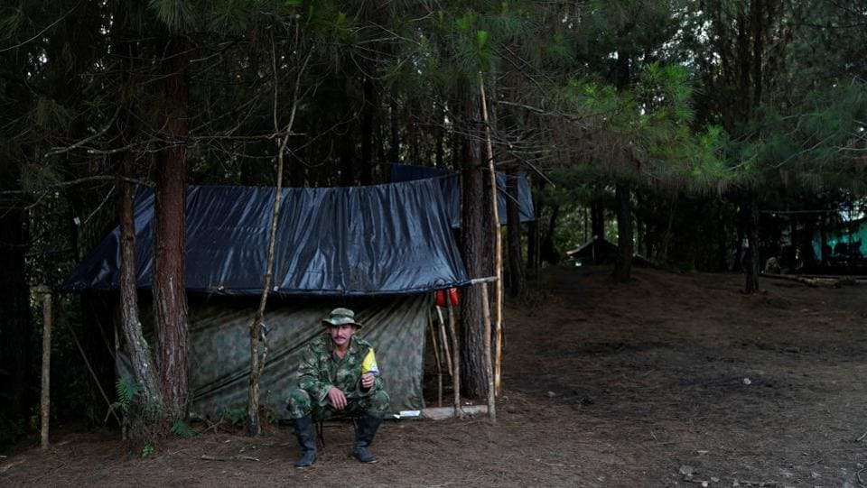 Juancho smokes a cigarette outside his makeshift tent in Los Robles, Colombia.  (Federico Rios/REUTERS)