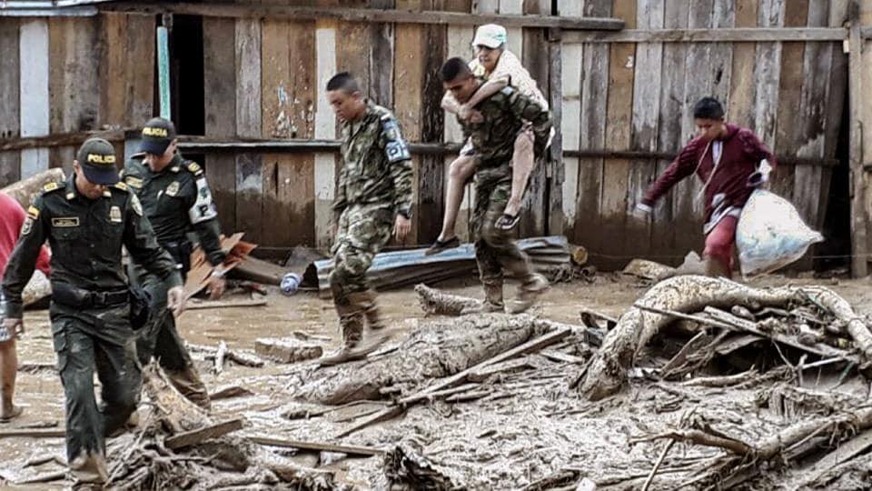 Handout picture released by the Colombian Army press office showing soldiers helping to evacuate locals following mudslides caused by heavy rains, in Mocoa, Putumayo department. Mudslides killed more than 200 people after heavy rains caused rivers to overflow in Colombia's Putumayo province, authorities said. (AFP)