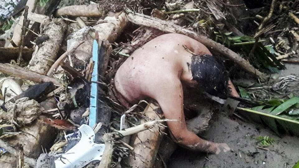 Hand-out picture released by the Colombian Army press office showing the corpse of a man caught in a mudslide caused by heavy rains, in Mocoa.  (AFP)