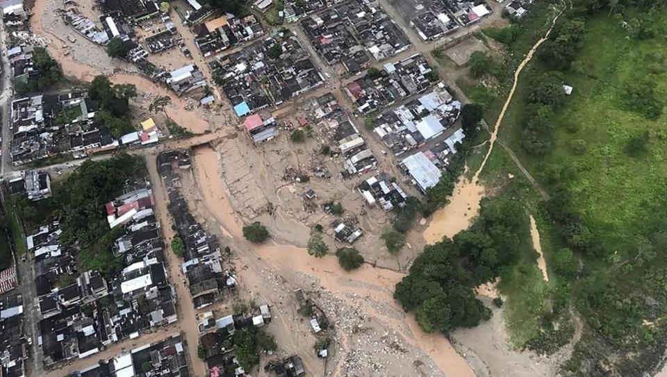 Handout picture released by the Colombian Presidential press office showing an aerial view of mudslides caused heavy rains, in Mocoa, Putumayo department. Mudslides in southern Colombia -caused by the rise of the Mocoa River and three tributaries- have claimed many lives.  (AFP)