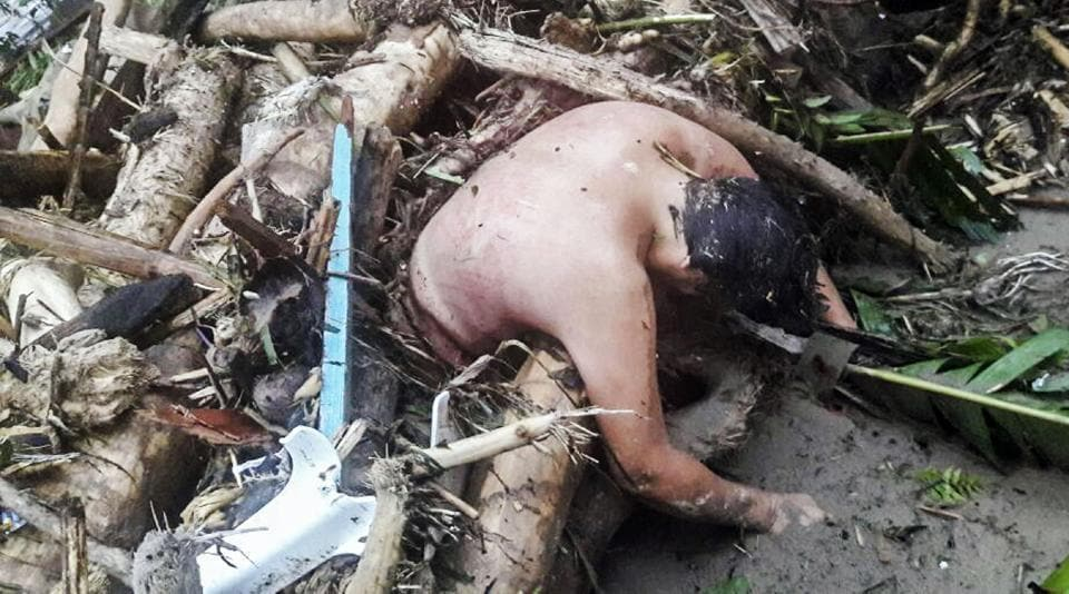 Handout picture released by the Colombian Army press office showing the corpse of a man caught in a mudslide caused by heavy rains, in Mocoa, Putumayo department, on April 1, 2017.