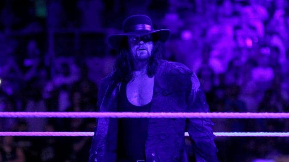 The Undertaker acknowledges the crowd after losing to Roman Reigns in the main event of WrestleMania 33, in what turned out to be the last match of his WWE career.