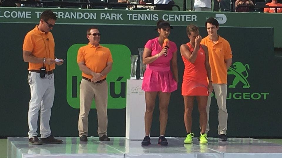 Sania Mirza addresses the crowd in Miami after she and her partner Barbora Strycova lost the women's doubles final on Sunday.