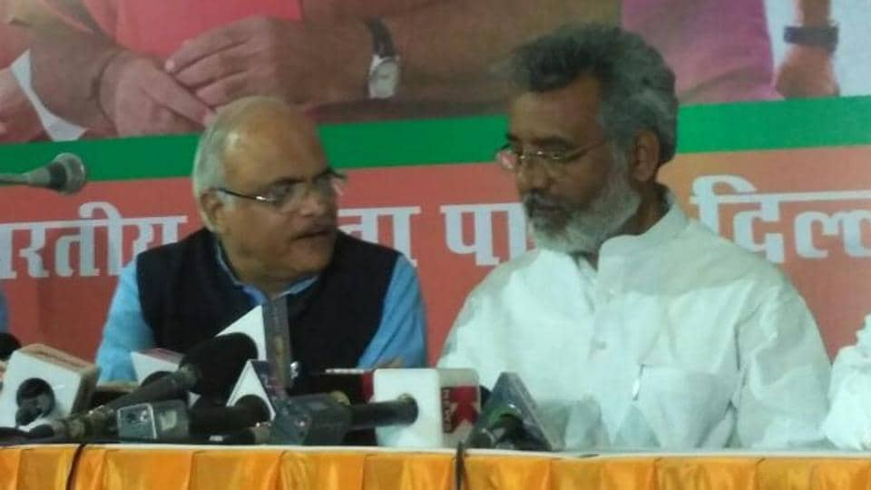 Former Congress MLA Amrish Singh Gautam (right) joins BJP in the presence of party vice-president Vinay Sahasrabuddhe and MLA Vijender Gupta.