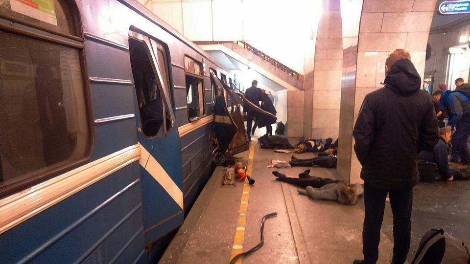 Blast victims lie near a subway train hit by a explosion at the Tekhnologichesky Institut subway station in St.Petersburg, Russia, Monday, April 3, 2017.