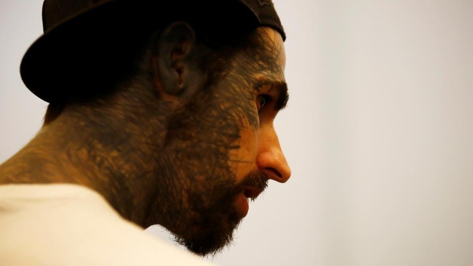 A man with tattoo on his face attends the Nepal Tattoo Convention. (Navesh Chitrakar / Reuters)