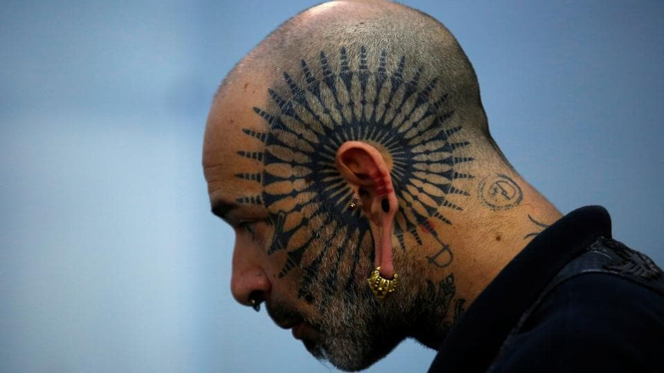 A man with tattoo on his face attends the Nepal Tattoo Convention in Kathmandu, Nepal. (Navesh Chitrakar / Reuters)