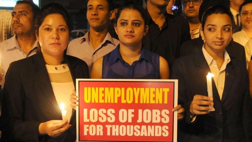 Employees of bars in Chandigarh holding candles and placards during a silent protest in Sector 26 against the implementation of the Supreme Court's booze ban order on Sunday.
