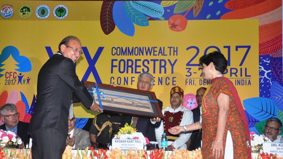 Indian Council of Forestry Research and Education DG Suresh C Gairola (L) and Forest Research Institute director Savita (R) present a memento to Governor KK Paul at Commonwealth Forestry Conference in Dehradun on Monday.