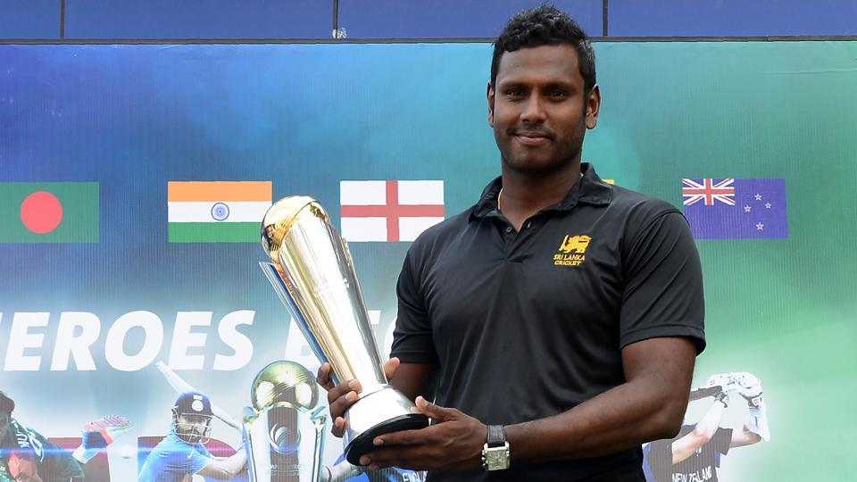 Sri Lanka cricket captain Angelo Mathews poses with the ICC Champions Trophy in Colombo on March 23, 2017. Mathews will miss the T20 series against Bangladesh