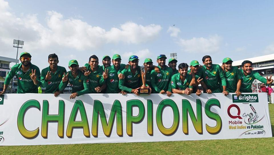 Pakistan's cricketers pose with their winning trophy at the end of the final of four-T20I-match between West Indies and Pakistan at the Queen's Park Oval in Port of Spain, Trinidad, on April 2, 2017. Pakistan won the match by 7 wickets to grab the series 3-1.