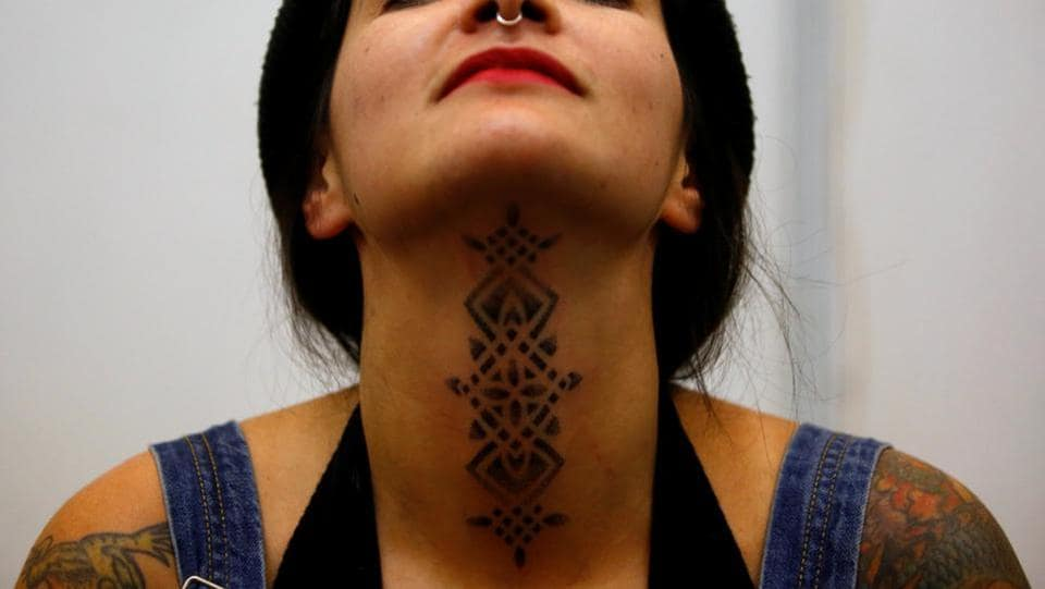 A woman shows her recently done tattoo during the Tattoo Convention. (Navesh Chitrakar / Reuters)