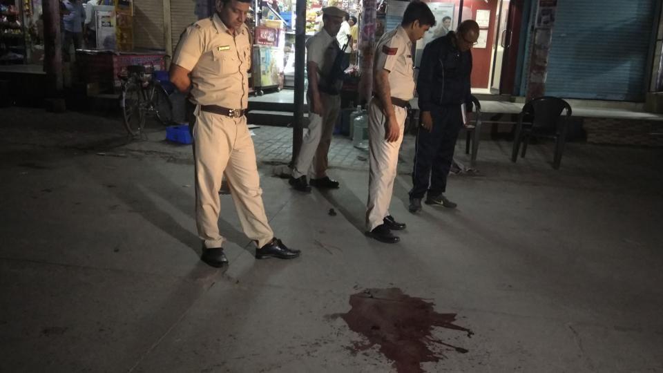 Policemen at the crime scene in Gurgaon's Sector 21.