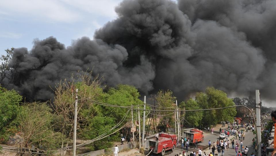 A huge cloud of smoke after fire engulfed PSTCL office in Pathankot Chowk area, in Jalandhar on Monday.