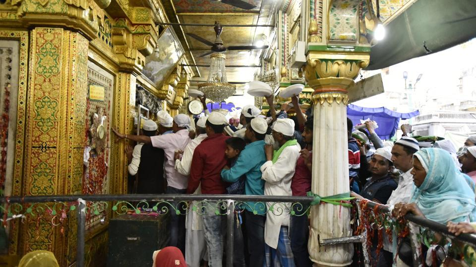 Thousands of Sufi devotees from different parts of India annually travel to the shrine of Sufi Muslim saint Hazrat Khwaja Muinuddin Chishti, in Ajmer, in the Indian state of Rajasthan for the annual Urs festival observed to mark his death anniversary, but they also offer their reverence at saint Nizamuddin Auliya Dargah in Nizamuddin West, New Delhi. (Burhaan Kinu/HT PHOTO)