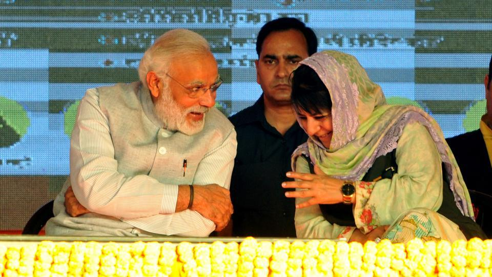 Jammu and Kashmir chief minister Mehbooba Mufti with Prime Minister Narendra Modi at a public rally after the inauguration of India's longest road tunnel on Sunday.