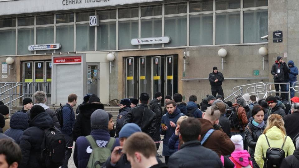 People gather outside Sennaya Ploshchad metro station after the explosion. Russia's National Anti-Terrorism Committee said it has found and deactivated a bomb at another subway station in St Petersburg. (Igor Russak/REUTERS)