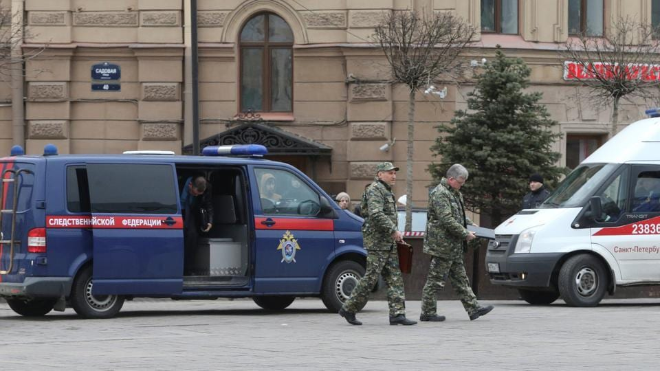 Members of security services walk past a vehicle of Russia's Investigative Committee outside Sennaya Ploshchad metro station after an explosion. At least 10 people were killed in a blast on a metro train in the Russian city of St Petersburg on Monday. (Igor Russak/REUTERS)