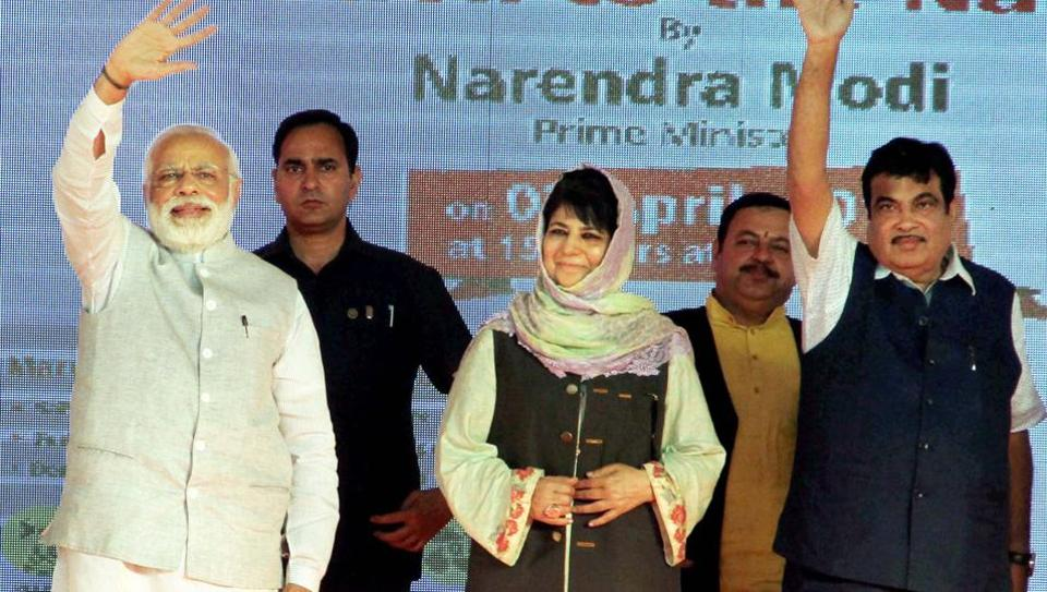 Prime Minister Narendra Modi (L), J&K chief minister Mehbooba Mufti (C) and Union transport minister Nitin Gadkari at a public rally in Udhampur, Jammu on Sunday, April 2, 2017.