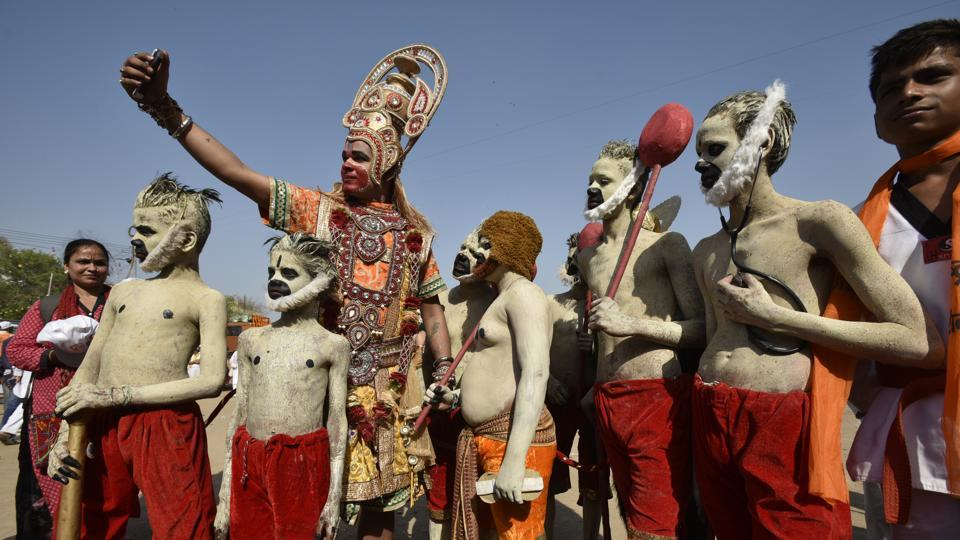 Artists dressed as lord Hanuman takes a selfie during a procession celebrating Ram Navami in New Delhi. (Raj K Raj/HT PHOTO)