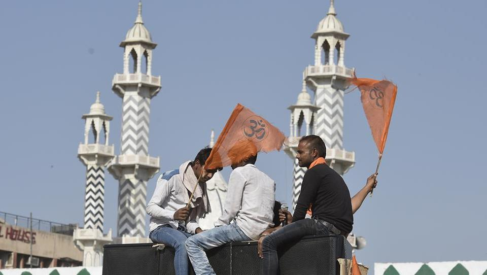 Hindu youth sit atop a truck before the start of the procession from Delhi's Ramlila Maidan to Karol Bagh. (Raj K Raj/HT PHOTO)