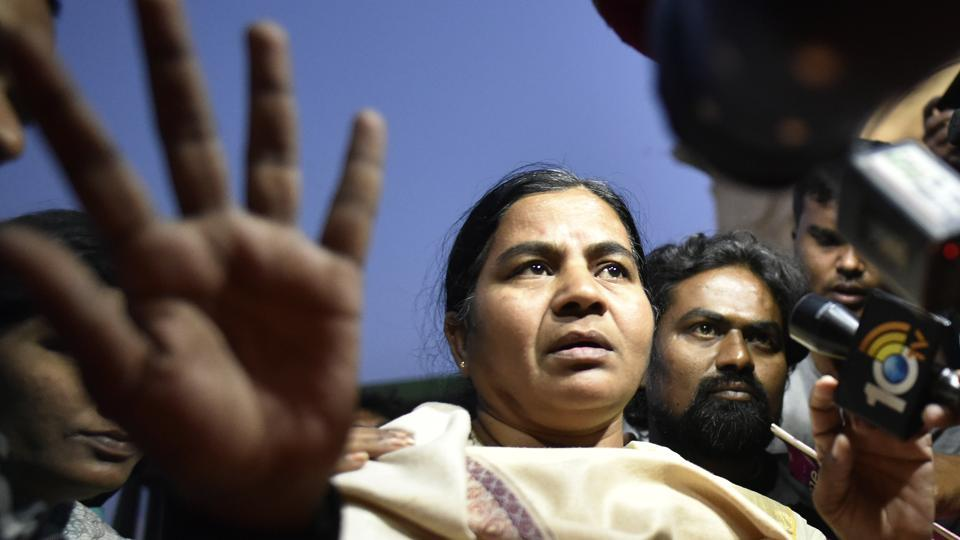 Rohith Vemula's mother Radhika Vemula detained by Delhi Police during the candle march in New Delhi,  February 24