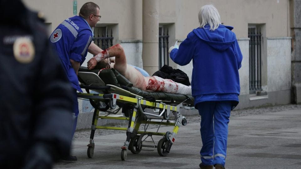 An injured person is helped by emergency services outside Sennaya Ploshchad metro station. Surveillance cameras in St Petersburg's metro system may have captured images of the person suspected of organising Monday's deadly train blast, Russian news agency Interfax quoted a source as saying. (Anton Vaganov/REUTERS)