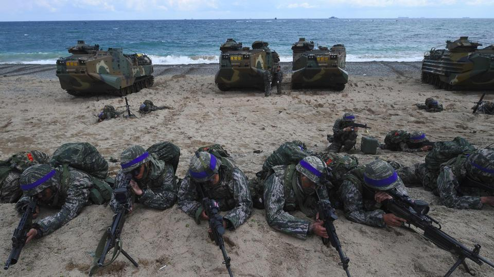 South Korean Marines take position on a beach during a joint landing operation by US and South Korean Marines in the southeastern port of Pohang on April 2.