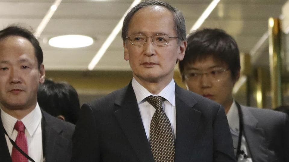 Japanese ambassador to South Korea Yasumasa Nagamine, center, leaves the foreign ministry in Seoul, South Korea, after Japan announced it would recall Nagamine and suspend economic talks in response to the placing of a